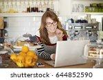 shot of a happy coffee shop... | Shutterstock . vector #644852590