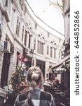 girl walking on old streets of... | Shutterstock . vector #644852866