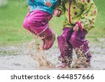 children in rubber boots and... | Shutterstock . vector #644857666