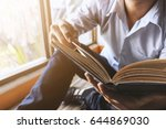 young man is sitting reading in ... | Shutterstock . vector #644869030