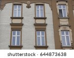 six windows on the facade of a... | Shutterstock . vector #644873638