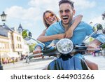 scooter ride. beautiful young... | Shutterstock . vector #644903266