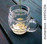 beer pouring into a glass mug