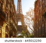 Eiffel Tower Between Buildings...