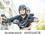 asian couple rider joyful with...   Shutterstock . vector #645016078