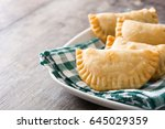 typical spanish empanadas on... | Shutterstock . vector #645029359