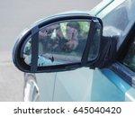 car with broken side door mirror | Shutterstock . vector #645040420