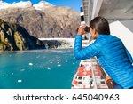 tourist looking at alaska... | Shutterstock . vector #645040963