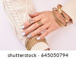 close up of female jewelry on... | Shutterstock . vector #645050794
