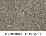 Small photo of Gravel showing through the abraded surface of a concrete plate