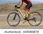 Small photo of Motion blur of a mountain bike race with the bicycle and rider at high speed