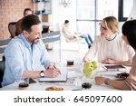 happy employee is looking at...   Shutterstock . vector #645097600