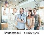 hilarious female manger is... | Shutterstock . vector #645097648