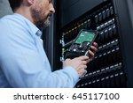 handsome serious man examining... | Shutterstock . vector #645117100