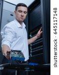 hard drive being taken by a... | Shutterstock . vector #645117148
