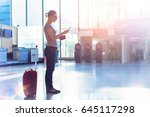 person reading flight boarding... | Shutterstock . vector #645117298