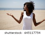 woman on a beach happy smile... | Shutterstock . vector #645117754