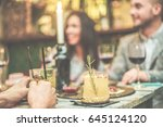 blurred friends enjoying... | Shutterstock . vector #645124120
