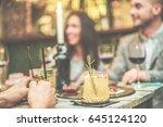 blurred friends enjoying... | Shutterstock . vector #645124120