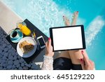 woman using tablet by the pool | Shutterstock . vector #645129220