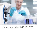 close up of test glasses being... | Shutterstock . vector #645131020