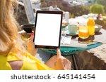 woman using tablet computer... | Shutterstock . vector #645141454