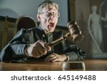 angry man a judge with a hammer ... | Shutterstock . vector #645149488