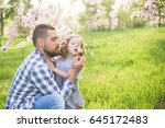 father and daughter blowing... | Shutterstock . vector #645172483