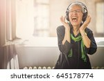 senior old woman listening to... | Shutterstock . vector #645178774