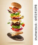 flying burger ingredients above ... | Shutterstock . vector #645191098