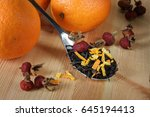 dry black tea with rose hips... | Shutterstock . vector #645194413