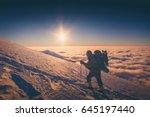 a climber with backpack climbs... | Shutterstock . vector #645197440