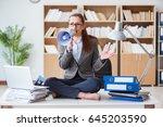 businesswoman with loudspeaker...   Shutterstock . vector #645203590