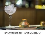 crystal glass with ice in a bar | Shutterstock . vector #645205870