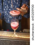 strawberry cocktail poured on... | Shutterstock . vector #645205930
