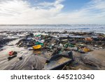 pollution of the beach during... | Shutterstock . vector #645210340