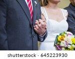 bride and groom holding hands...   Shutterstock . vector #645223930