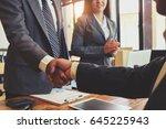 business handshake and business ... | Shutterstock . vector #645225943