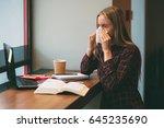 sick student blowing his nose... | Shutterstock . vector #645235690