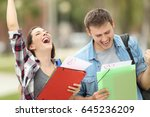Two Excited Students With...