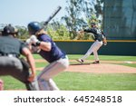 baseball pitcher winding up to... | Shutterstock . vector #645248518