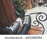 legs of woman with sneakers | Shutterstock . vector #645280096
