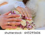 hands and rings on wedding... | Shutterstock . vector #645295606
