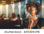 young curly black female in... | Shutterstock . vector #645304198