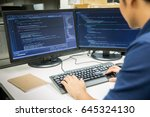 male programmer working on... | Shutterstock . vector #645324130