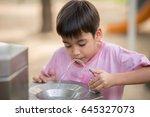 Little Asian Boy Drinking Wate...