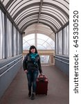 girl with a suitcase is walking ... | Shutterstock . vector #645330520
