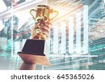 win concept man holding up a... | Shutterstock . vector #645365026