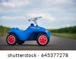 blue toy car on street... | Shutterstock . vector #645377278