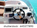 control panel and helm on motor ... | Shutterstock . vector #645377890